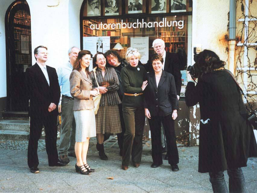 A group of authors who co-own Autorenbuchhandlung outside the bookshop, 2006.