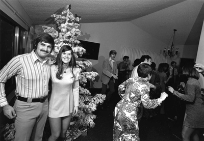 Bill Owens, 'We really enjoy getting together with our friends to drink and dance. It's a wild party and we're having a great time . . . ', 1972, black-and-white photograph. From Suburbia (Straight Arrow Books, 1973).