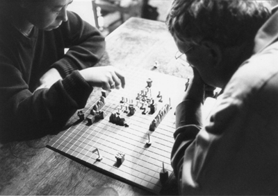 Alice Becker-Ho and Guy Debord playing the Game of War, 1977.
