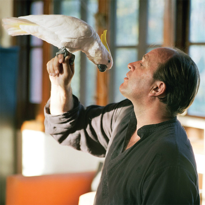 William Dalrymple with Albinia, his pet cockatoo, at home in New Delhi.