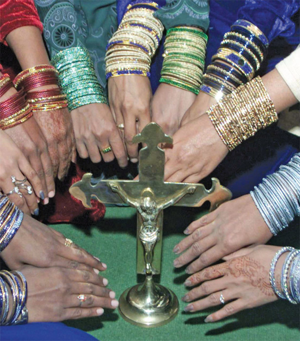 Catholic women show their bangles at a Christmas celebration in Multan, December 23, 2002.