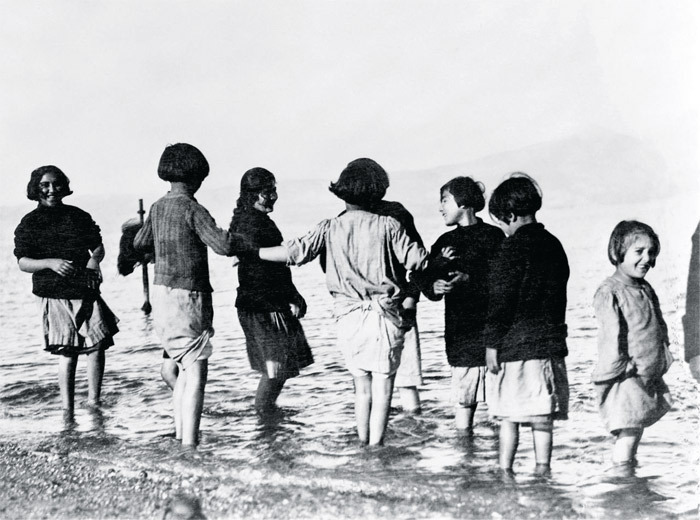 Greek and Armenian orphan refugees experiencing the sea for the first time, Marathon, Greece.