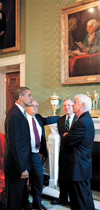 President Barack Obama meets with (from left) Representative Barney Frank and Senators Dick Durbin and Chris Dodd in the White House Green Room, June 17, 2009.