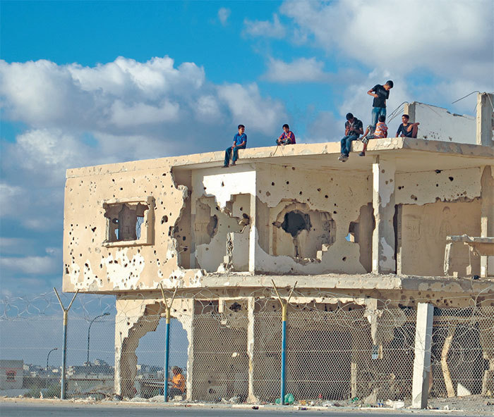 Children atop a bullet-riddled building in Gaza, 2011.