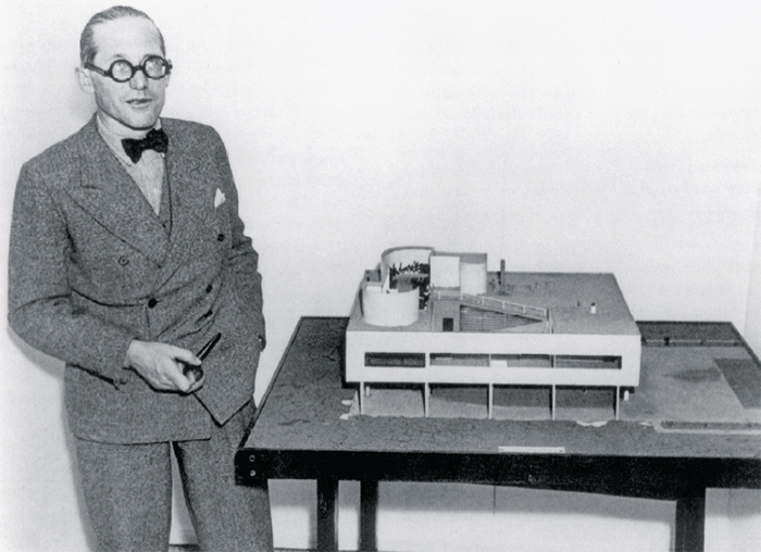 Le Corbusier with a model of the Villa Savoye, 1935.