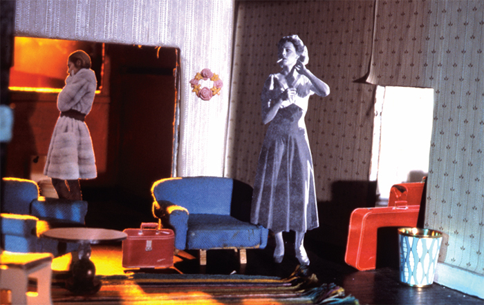 "Laurie Simmons, Study for Longhouse (Red Suitcase), 2003, C-print, 27 1/2 × 40""."