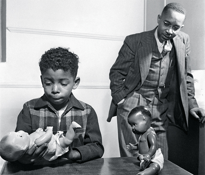 Dr. Kenneth B. Clark studying a child's reactions to white and black dolls, 1947. © Gordon Parks Foundation, Courtesy Library of Congress