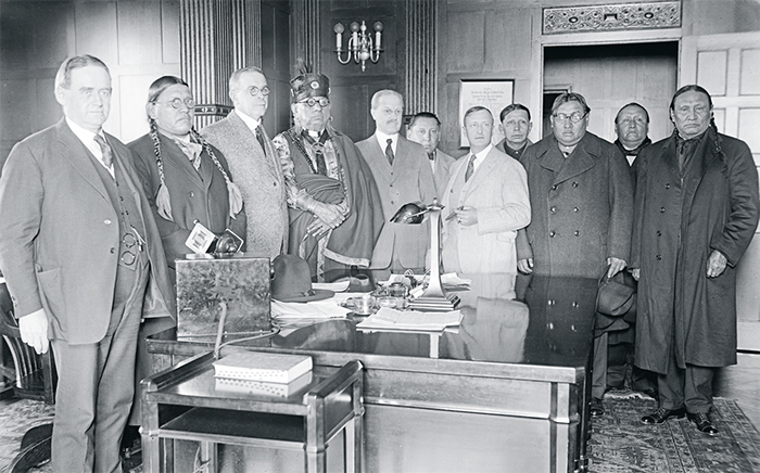 A meeting of the Council of the Osage Indian Tribe and United States government officials in Washington, DC, ca. 1921–24.Harris & Ewing/Library of Congress.