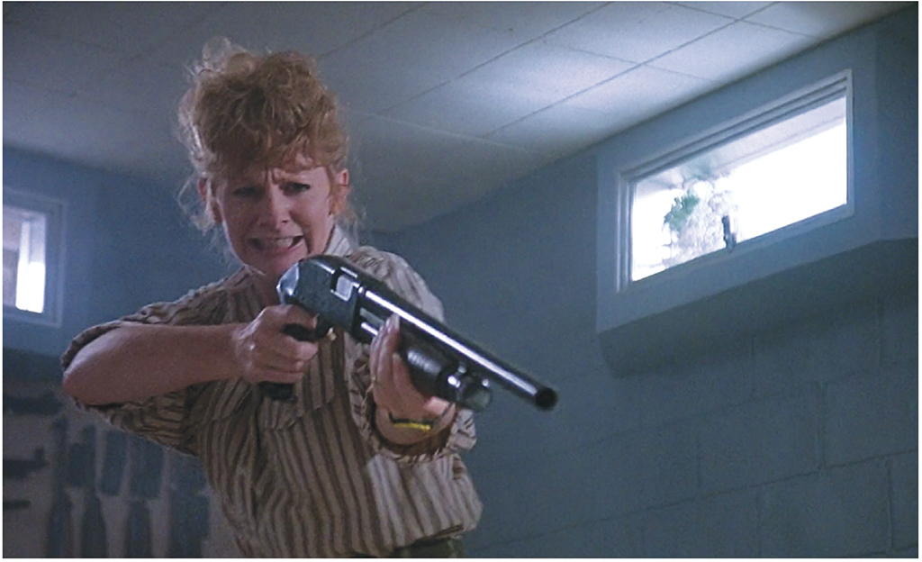 Reba McEntire in Ron Underwood's Tremors, 1990. Stampede Entertainment.