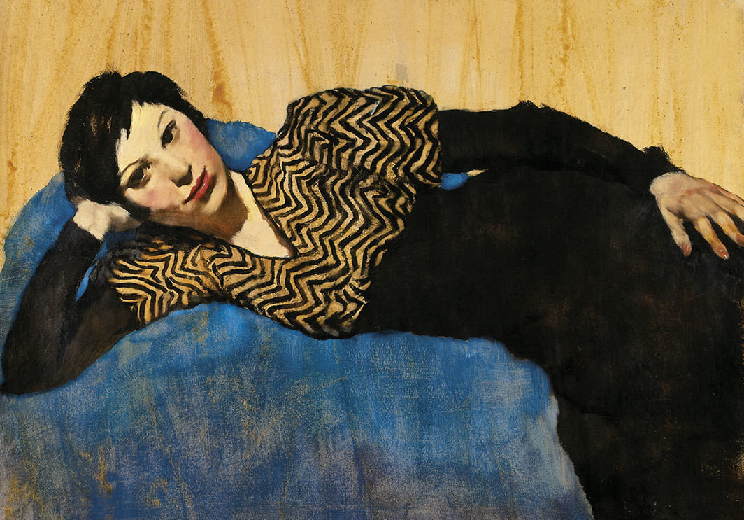 "Lotte Laserstein, Girl Lying on Blue, ca. 1931, oil on paper, 27 1⁄8 × 36 5⁄8""."