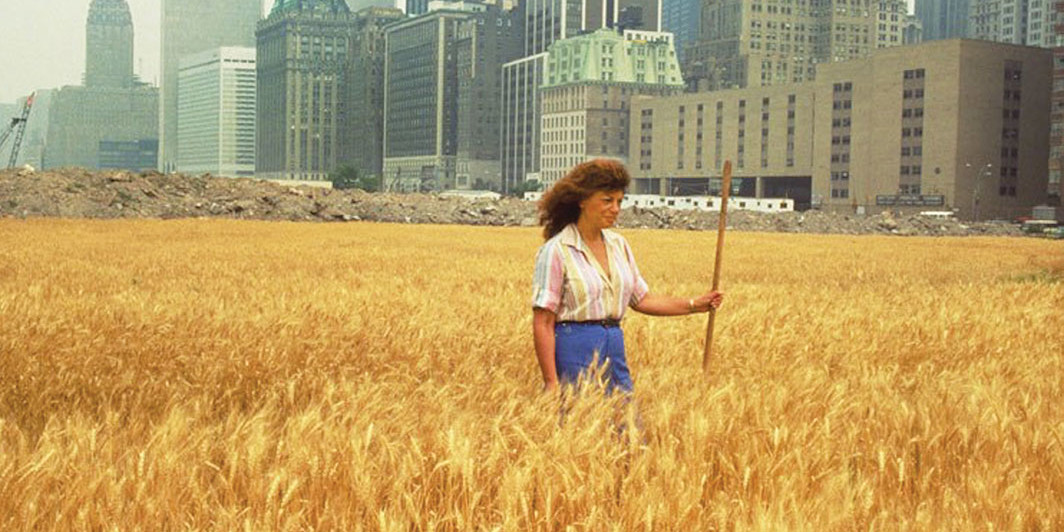 Agnes Denes with her Wheatfield: A Confrontation, 1982, New York. John McGrall; Courtesy the artist and Leslie Tonkonow Artworks + Projects