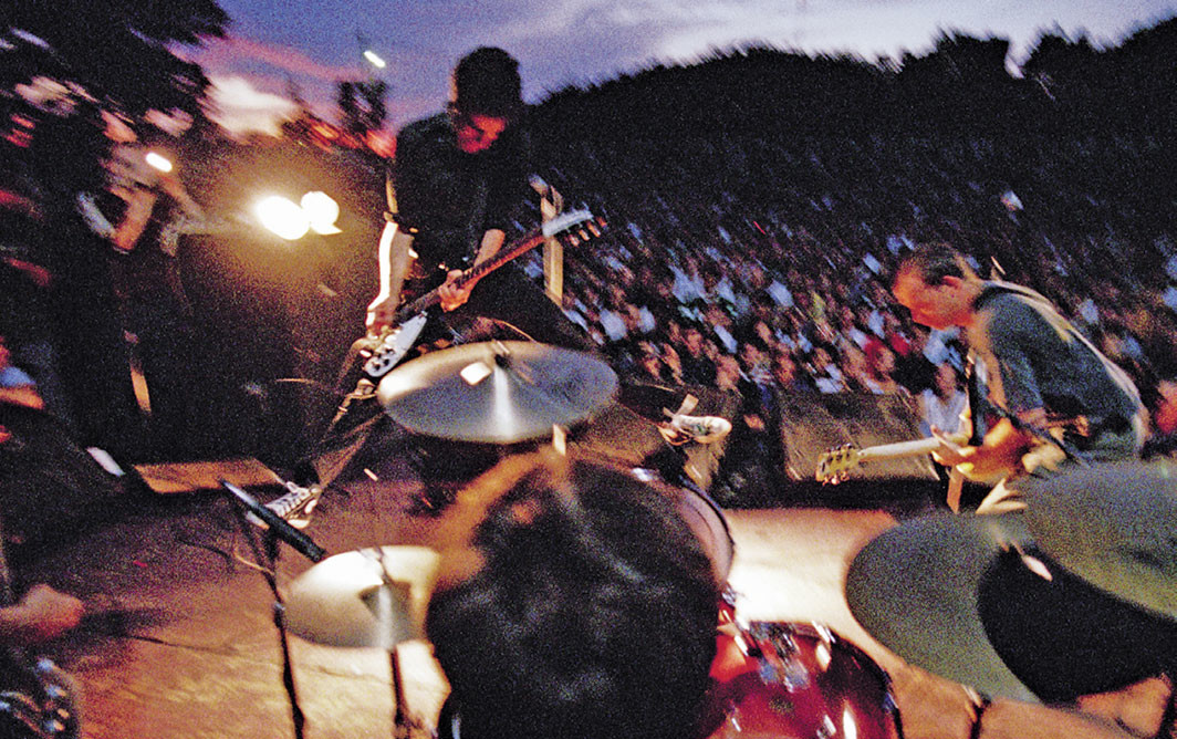 Fugazi performing at Fort Reno, Washington, DC, 1997. © Glen E. Friedman, Courtesy Akashic Books