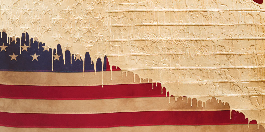 "Andrew Schoultz, Weathered Flag (Gold Dip), 2016, acrylic and 24-karat gold leaf on stained and dyed American flag on panel, 30 × 54"". Courtesy the artist and Joshua Liner Gallery"