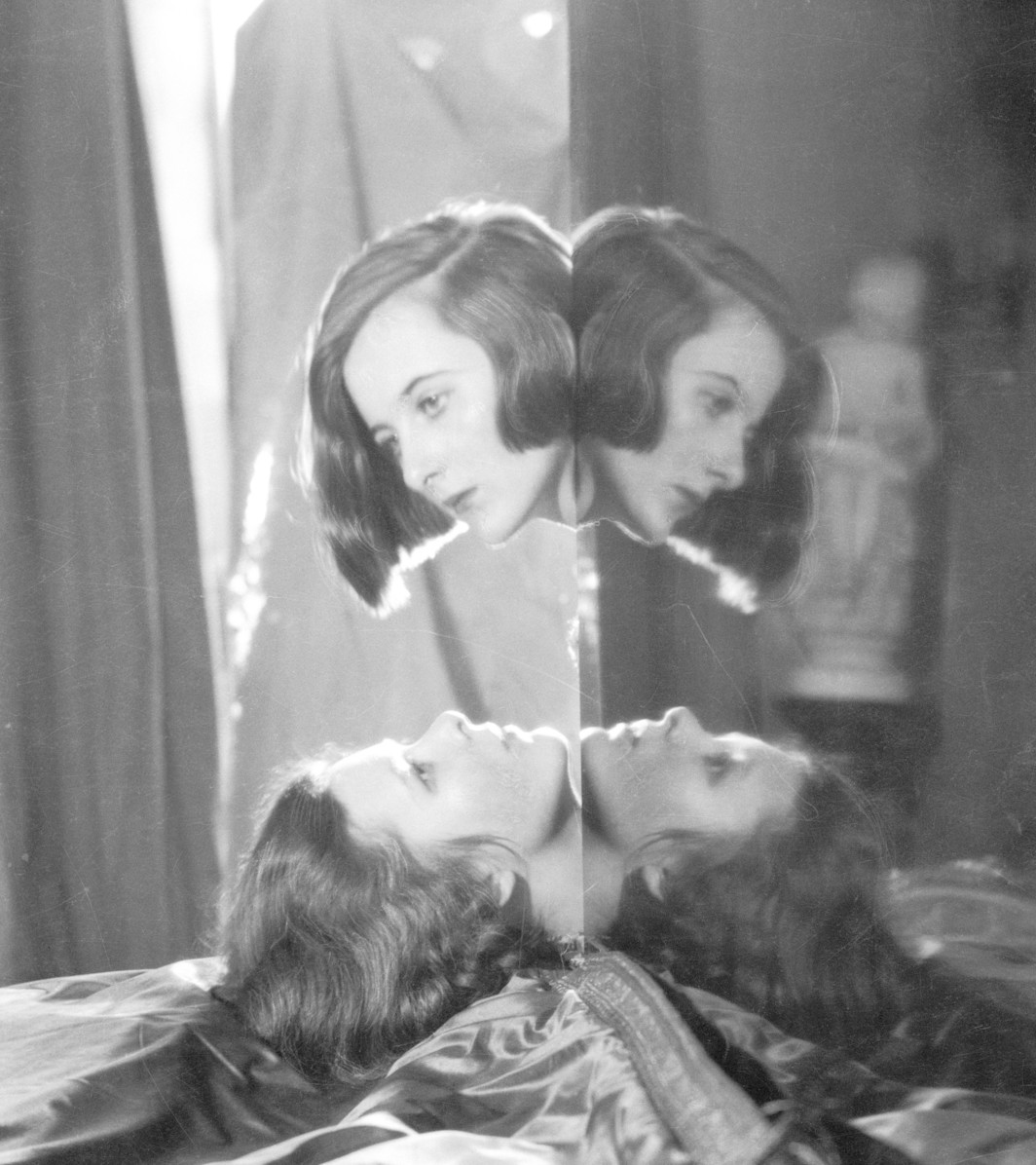 "Cecil Beaton, Nancy and Baba Beaton Reflected in Piano Lid, 1926, gelatin silver print, 7 5/8 x 6 7/8""."