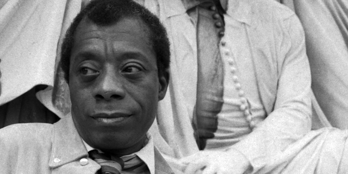Portrait of James Baldwin with the statue of Shakespeare Albert Memorial. Photo: Allan Warren/WikiCommons